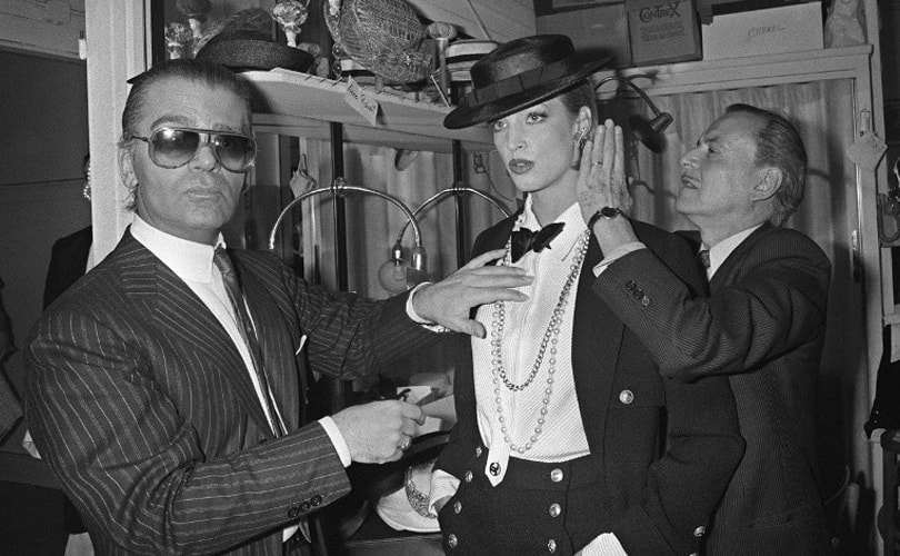 Lagerfeld prepping a model for the Chanel runway