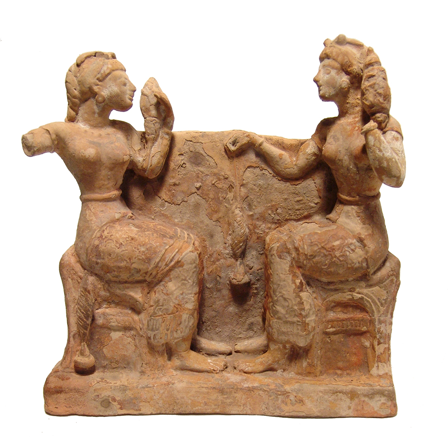 Greek terracotta relief scene
