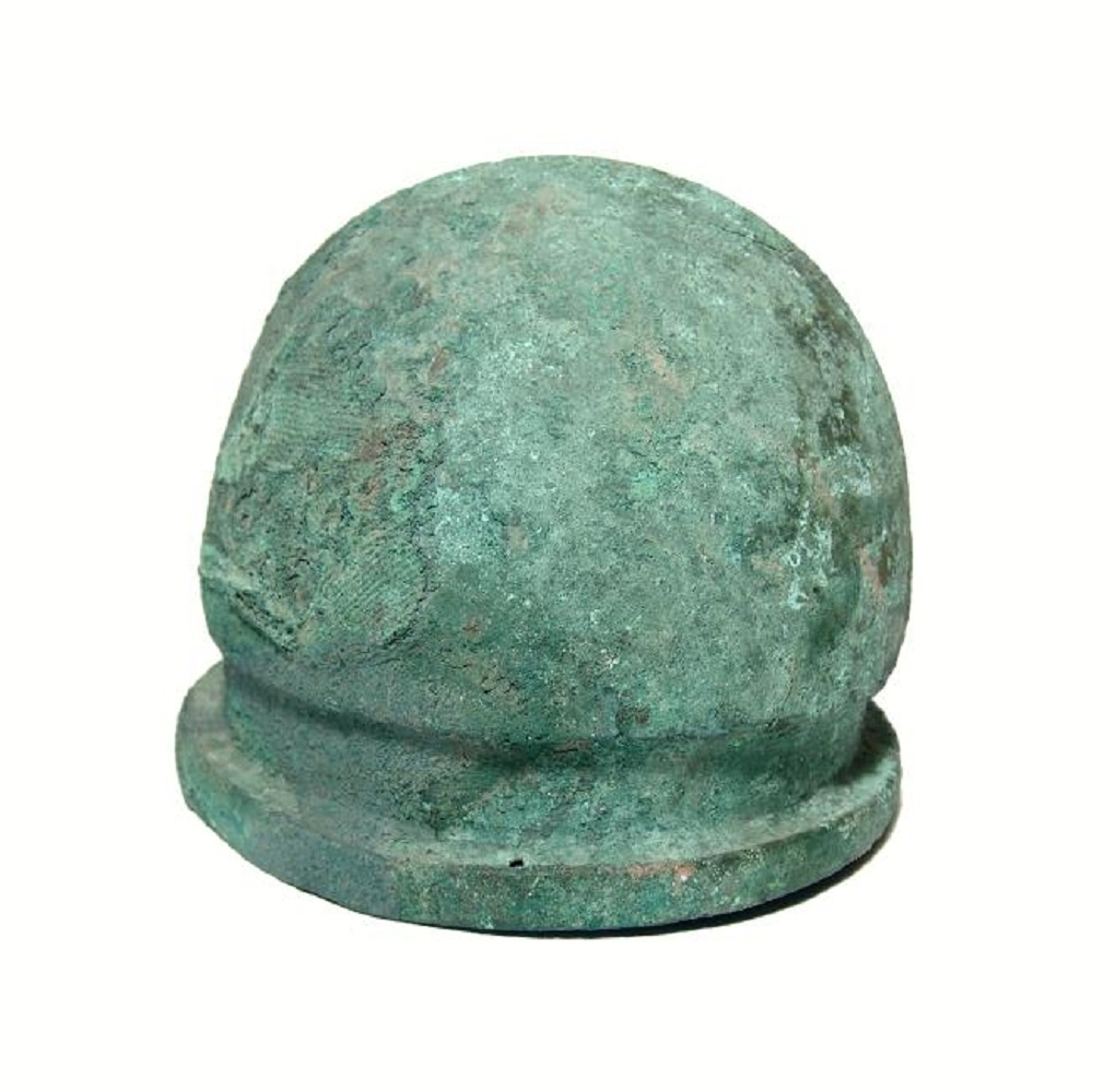 Rare, circa 450-350 BC Etruscan bronze helmet of Negau type, believed to have been used by priests and likely buried for ceremonial reasons, 7 ½ inches tall (est. $15,000-$20,000).