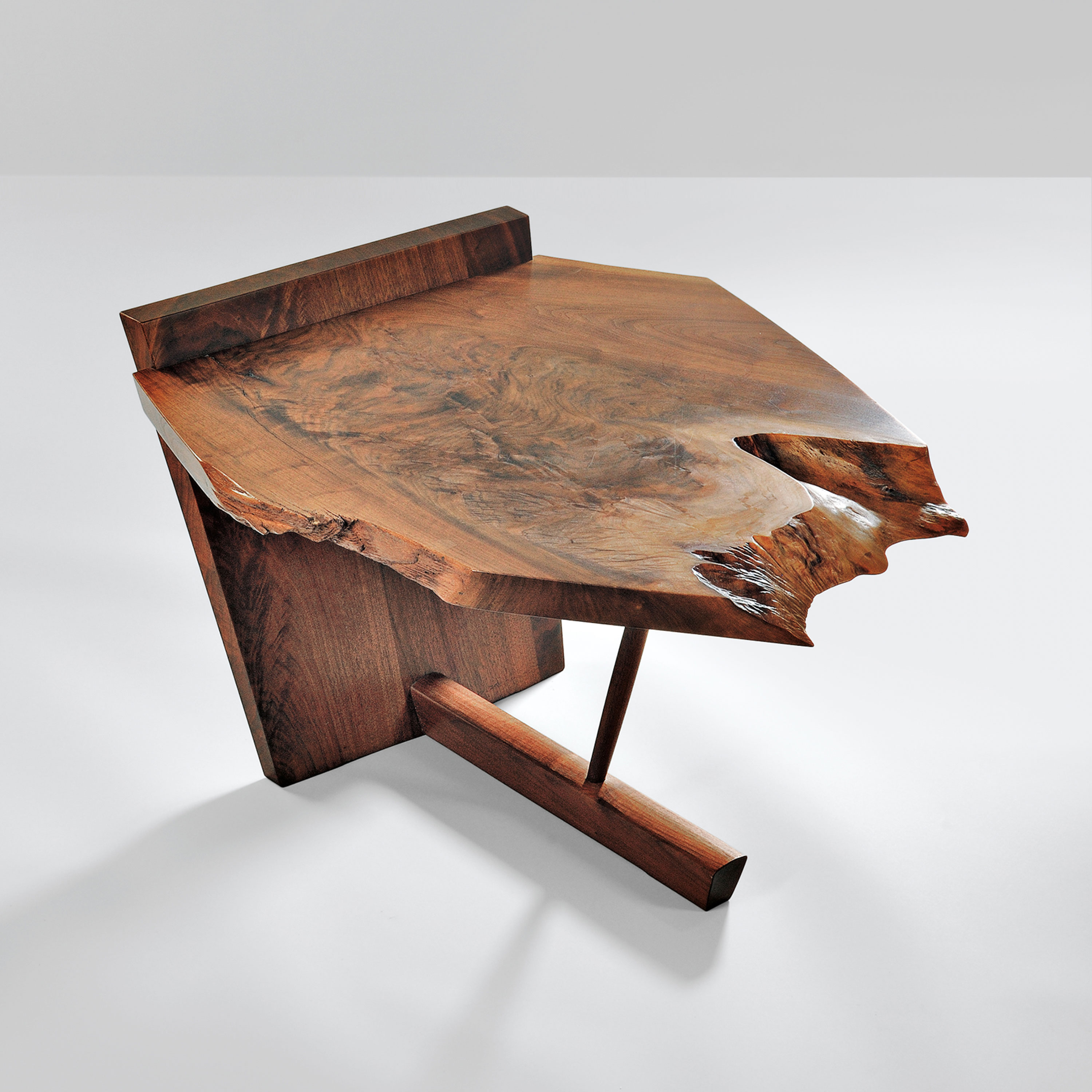 A a low table, 1976, cut from a slab of American black walnut