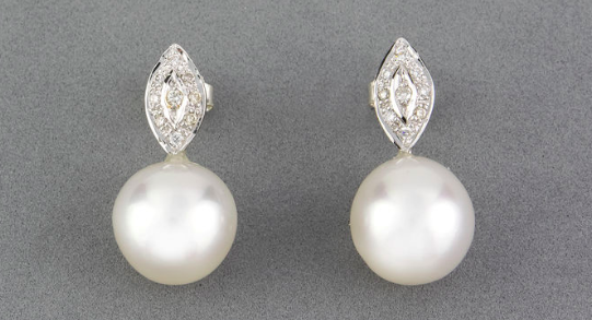 Pair of diamond earrings and pearls $250
