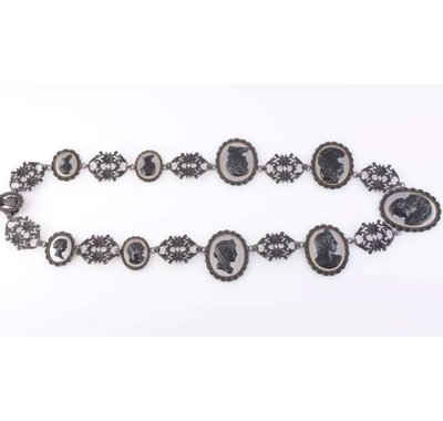 A Berlin ironwork necklace, early 19th Century, the ten graduating oval cameo mounts with scalloped edge detailing each applied to the centre with the profile of a lady or gentleman