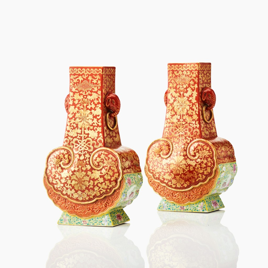 A pair of rare vases in iron-red and gilt