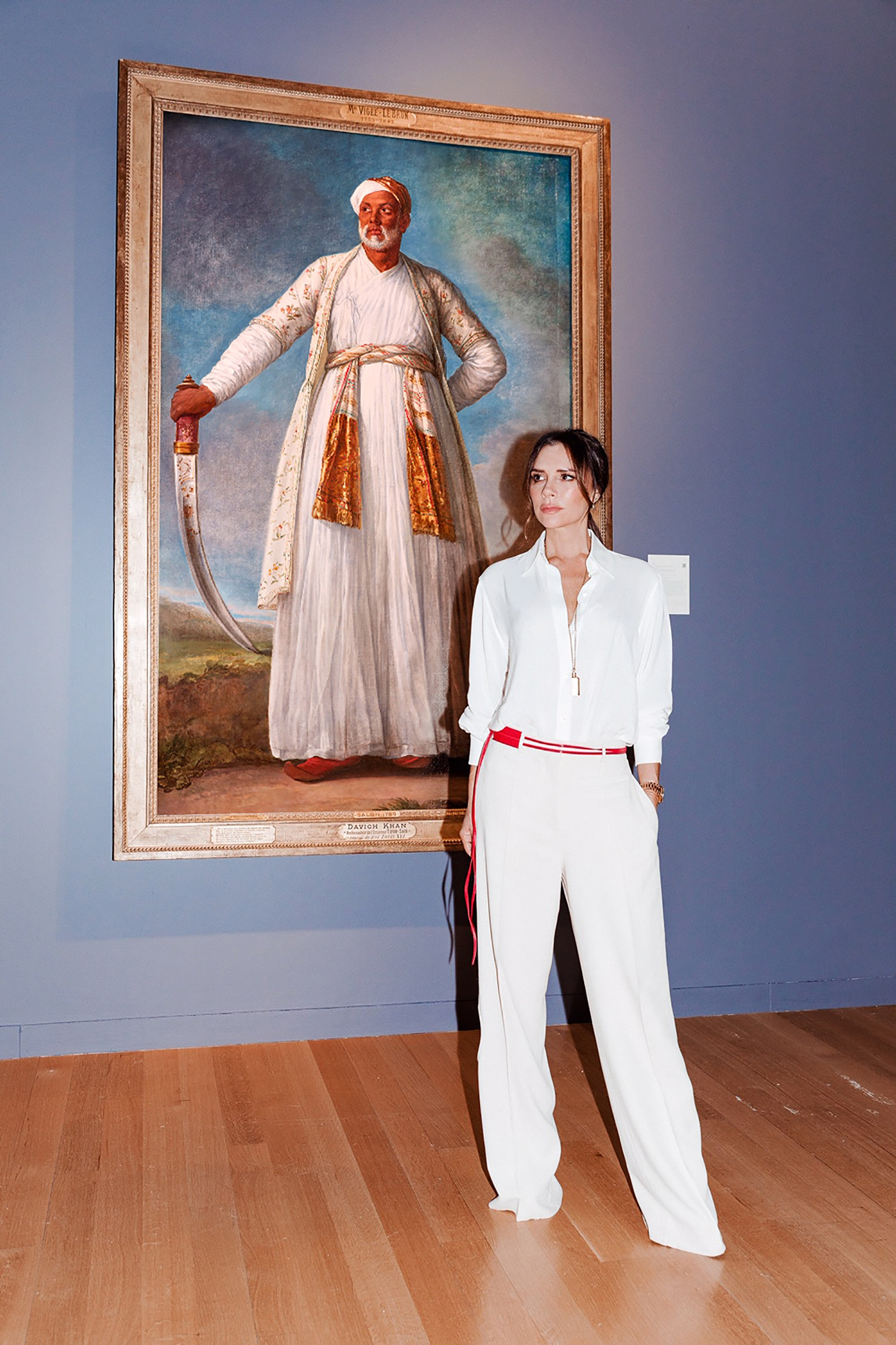 """Victoria Beckham stands next to Vigee Le Brun's portrait of the Indian ambassador to celebrate the """"Female Triumphant,"""" 21 works of female Old Masters auctioned at Sotheby's in January. Photo: Tom Newton, Vogue"""