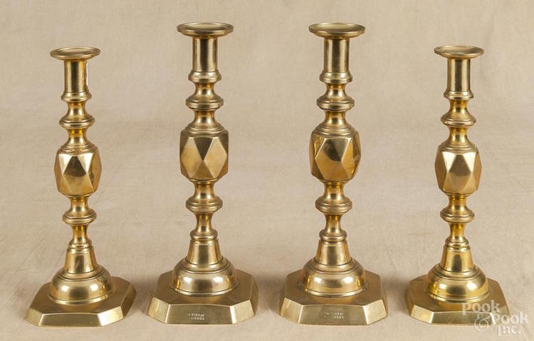 Two pairs of English brass candlesticks, 19th c., stamped King and Queen of Diamonds, 12 1/2'' h. Estimate $300 - $500. Photo via Pook & Pook
