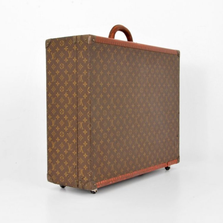 Louis Vuitton Travel Suitcase. Estimate $1,500 – $2,000.