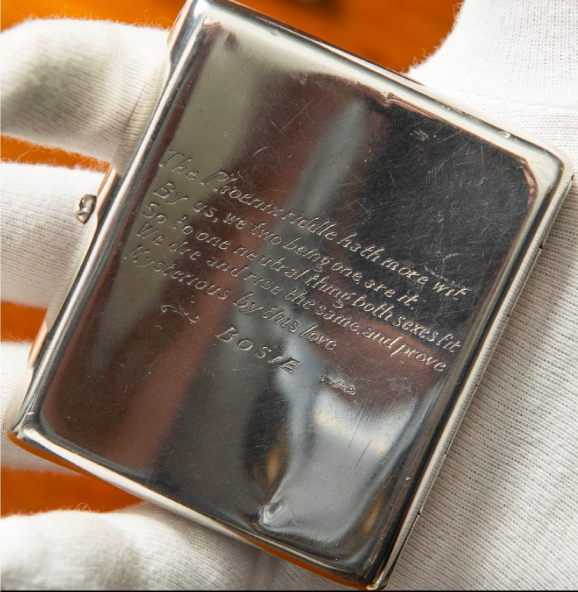 A silver cigarette case of plain concave rectangular form with push button lock engraved with verses and signed Bosie hallmarked Birmingham 1897 with maker s mark J.M.M. Photo: Henry Aldridge & Son