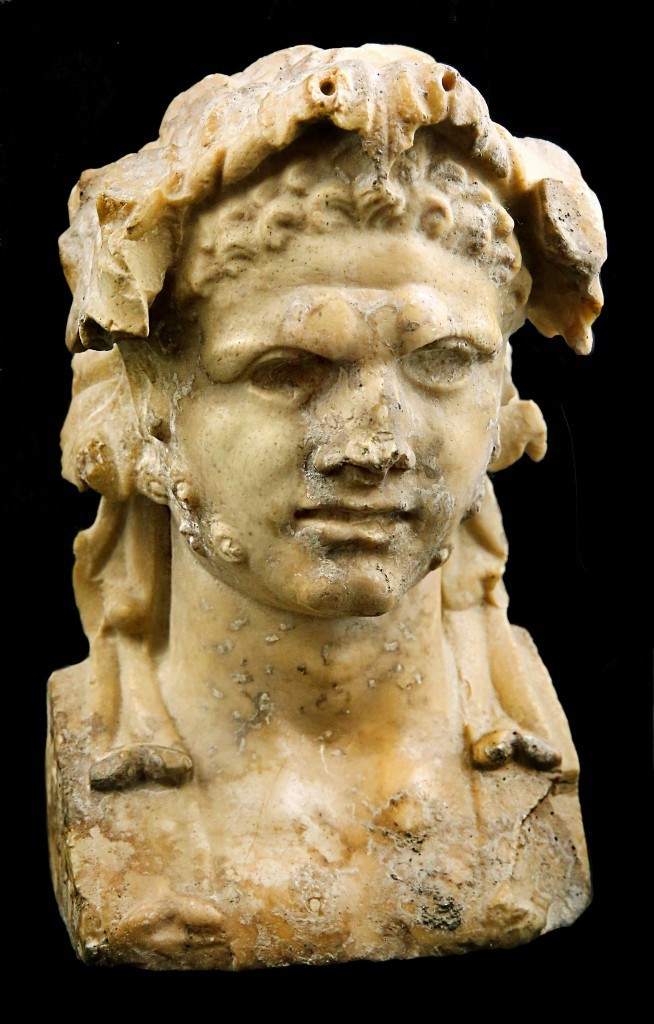 Dionysian herme, antique yellow marble, H: 18 cm, 1st century