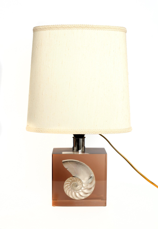 An acrylic lampbase incorporating a cut shell, 1970s.