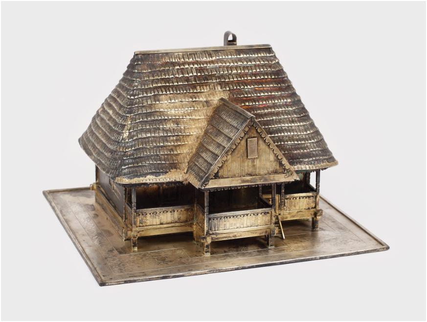 Modell av Nicolae Ceauşescu födelseort i Scornicesti - från Ceausescus privata samling, trä och mässing Utropspris: 2,800 SEK. Artmark.