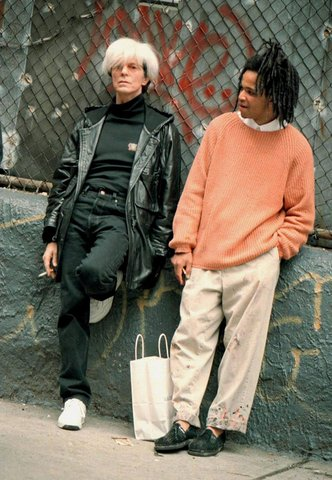 Bowie playing Warhol alongside Jeffrey Wright in Schnabel's 1996 movie Image via Vogue
