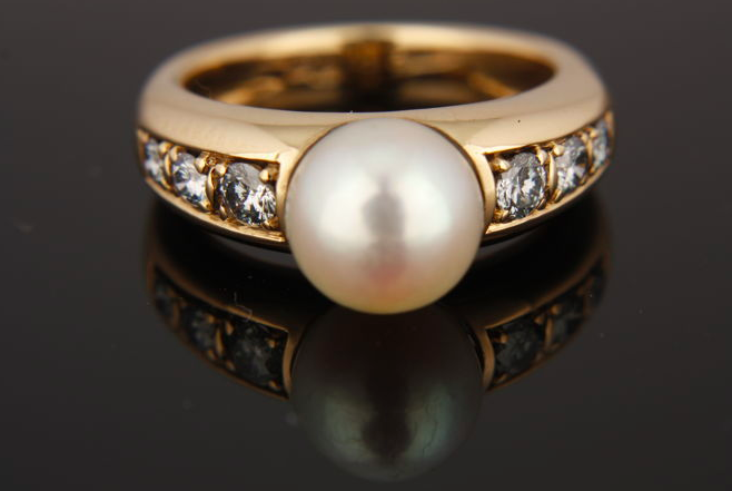 Gold ring, diamonds and cultured pearlSold for $500