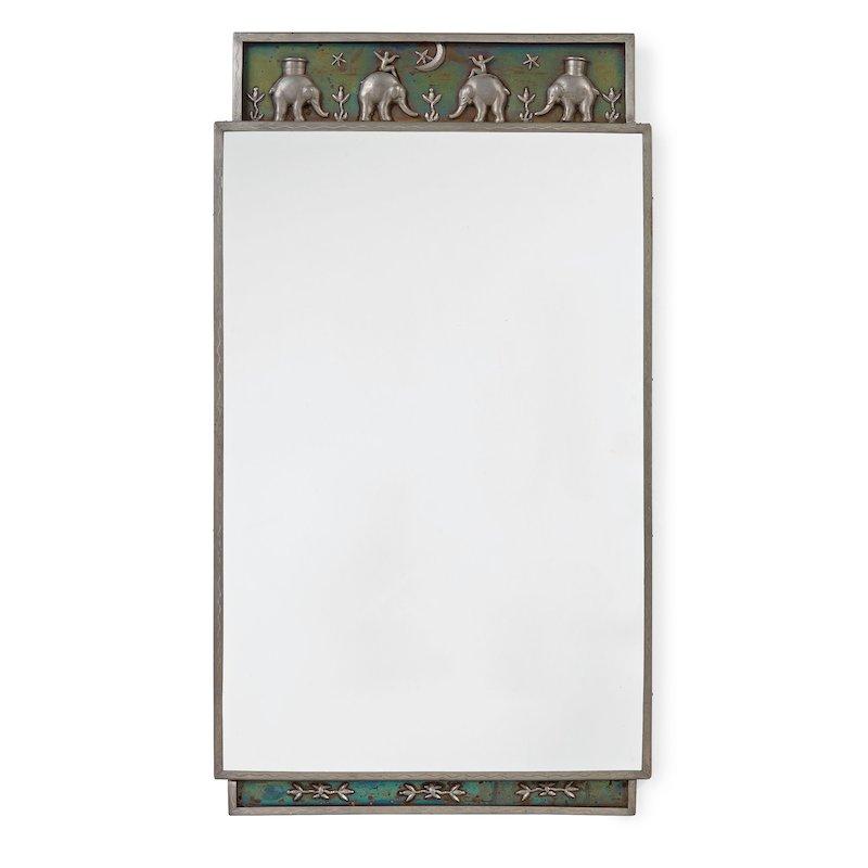 Nils Fougstedt, sannolikt, spegel, Firma Svenskt Tenn. Stockholm 1932. Tenn, krön med dekor av bl a elefanter. Stämplad med änglamärket Stockholm F8. 90 x 50,5 cm. På auktion hos Bukowskis
