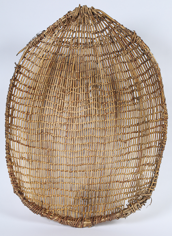 Large, circa 1900 winnowing basket, 28 ½ inches long by 21 ½ inches wide, with open basket twining, utilitarian (but never utilized), a pine nut harvest relic from the Great Basin ($1,750).