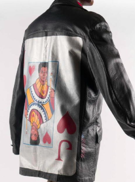 """Leather jacket with an image of Jean-Michel Basquiat's face inside a Jack of Hearts card on the back, signed """"Rags"""", believed to have been done by Michael J. Raglin"""