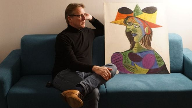 Arthur Brand with the stolen Picasso. Image: BBC