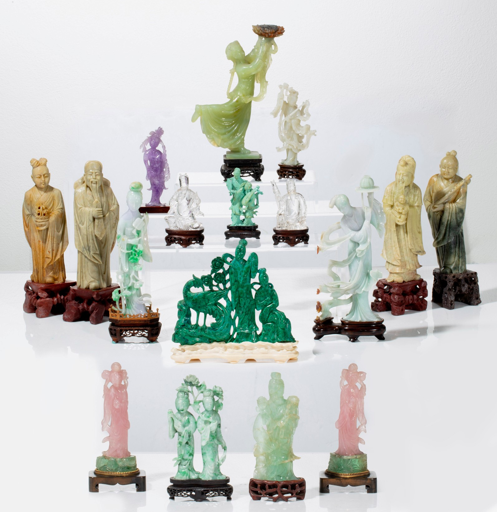 Collection of Chinese hardstone figural carvings (est. $1,000-$2,000).