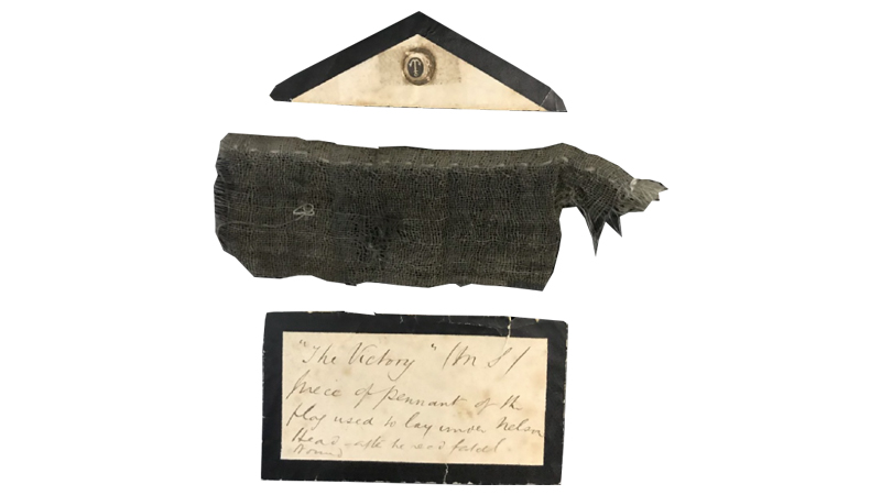 A fragment of cloth said to come from the flag of the HMS Victory. Image: Henry Aldridge