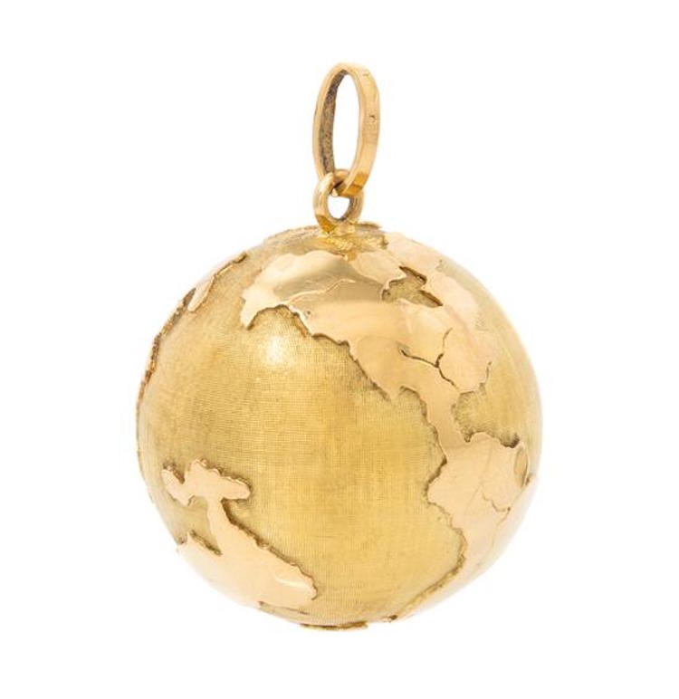 An 18 Karat Yellow Gold Globe Pendant. Estimate $200 - $300. Photo via Leslie Hindman Auctioneers