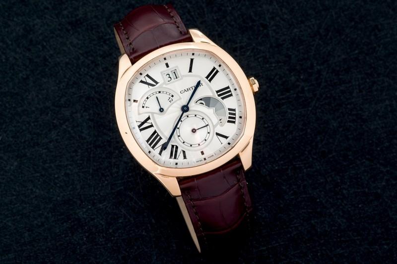 Cartier, lotto 159, Orologio da polso modello Drive in oro rosa .