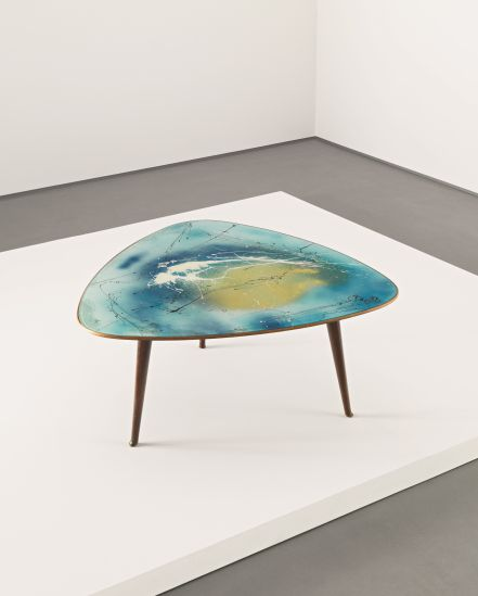 Osvaldo Borsani and Lucio Fontana Rare coffee table, 1952 Reverse hand-painted glass, walnut. Sold at Phillips in 2012