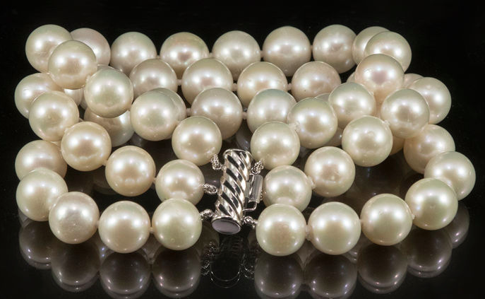 Necklace of three rows of cultured pearlsSold for $150