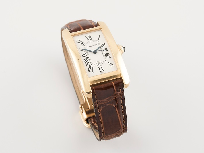 "CARTIER - Armbanduhr ""Tank Americaine"" aus Gelbgold Ausruf: 3.000 EUR"