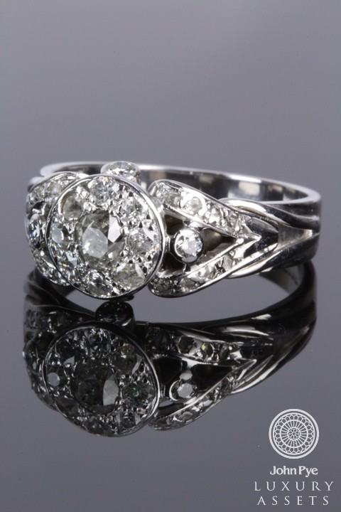 Circular cluster ring of old and brilliant-cut diamonds. Photo: John Pye.
