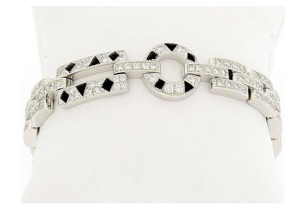 """CARTIER - Armband """"Panthère"""" aus Weißgold mit Brillanten (4,70 ct) und 10 Onyx (0,22 ct) Schätzpreis: 16.000-22.000 CHF"""