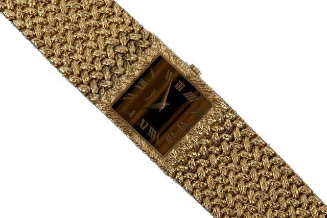 PIAGET - Montre ruban en or jaune tressé - Cadran carré à fond oeil de tigre Azur Enchères Cannes
