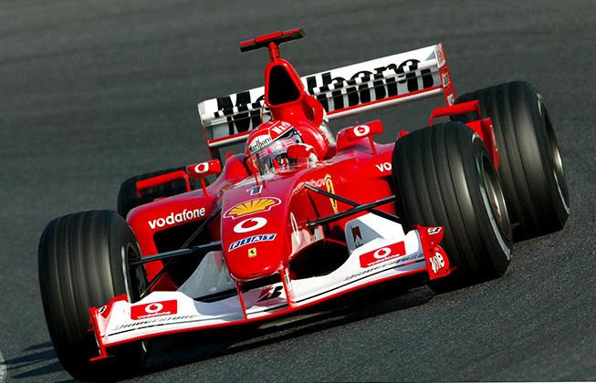 Michael Schumacher in einem Formel 1-Wagen von Ferrari | Foto via f1i.com