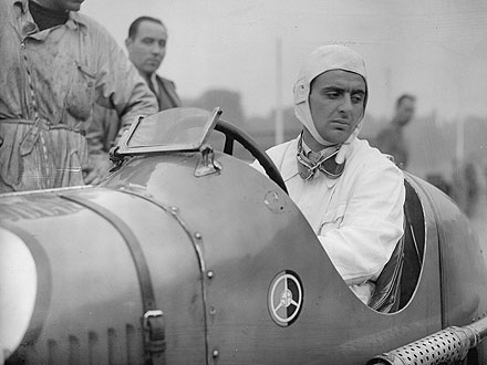 Luigi Villoresi sits in his Maserati whilst preparations continue for Britain's finest international car race at Crystal Palace Image via BBC