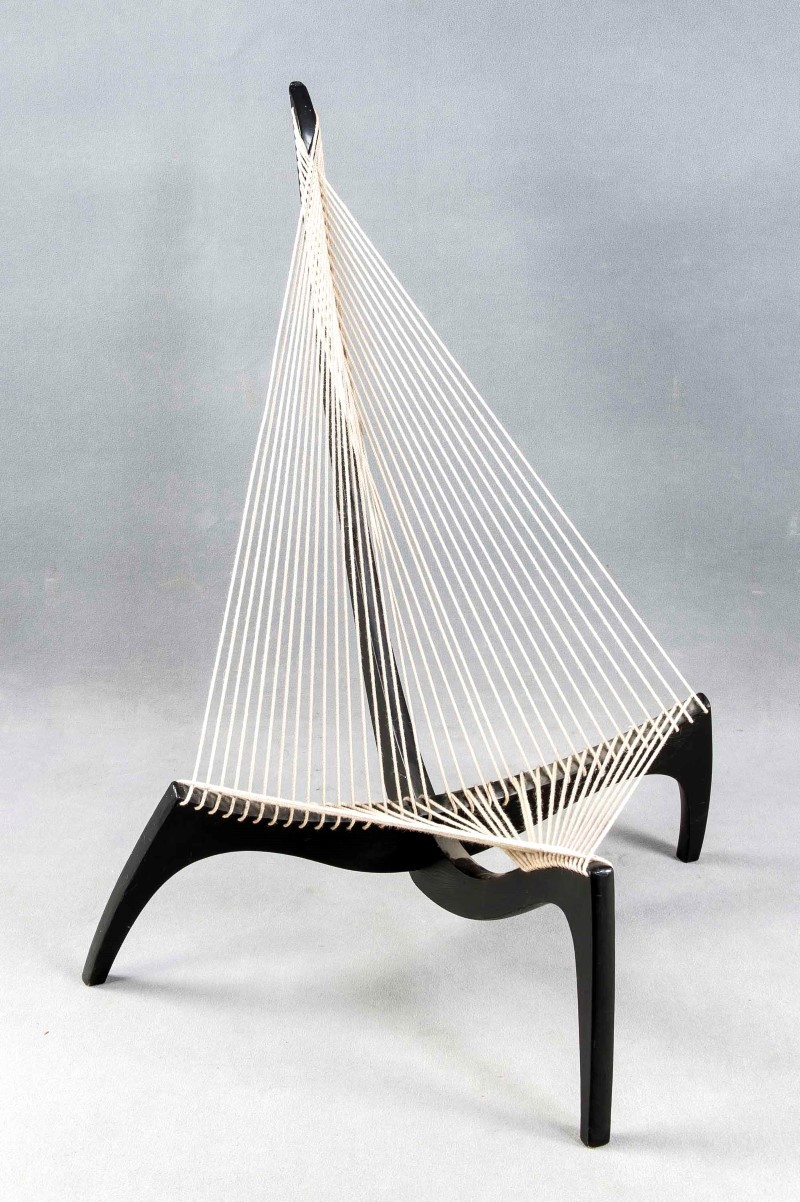 Harp Chair, Design Jörgen Hovelskov 1963, execution probably by Christensen & Larsen, black-stained ash wood, rope lining, without company logo. See '1000 Chairs', p. 309, and 'Scandinavian Furniture' p. 122, minor wear and tear, 130 x 114 x 110 cm. Estimate: $900