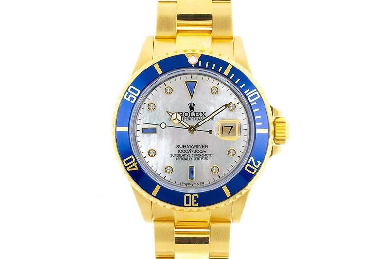 ROLEX Oyster Perpetual Date Submariner en oro amarillo para caballero